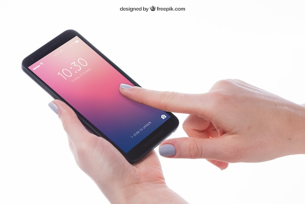 Mockup of finger pointing at smartphone Free Psd