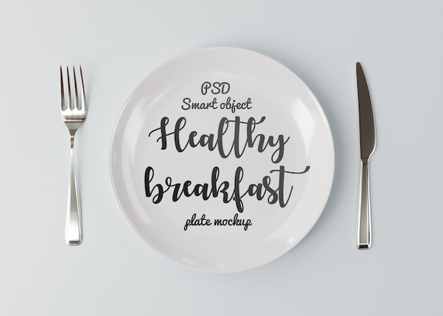 Mockup fork with a knife near the plate on white Premium Psd