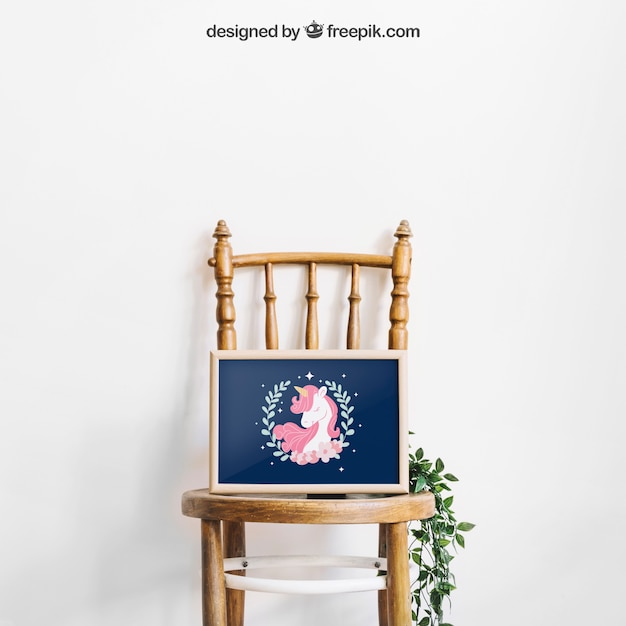 Mockup of frame on chair Premium Psd