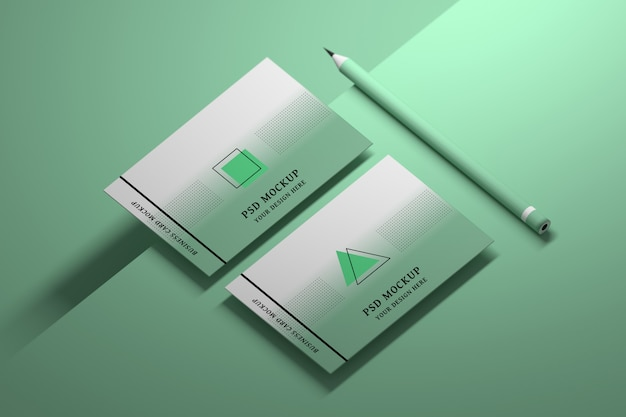 Mockup of green business cards with pencil Premium Psd