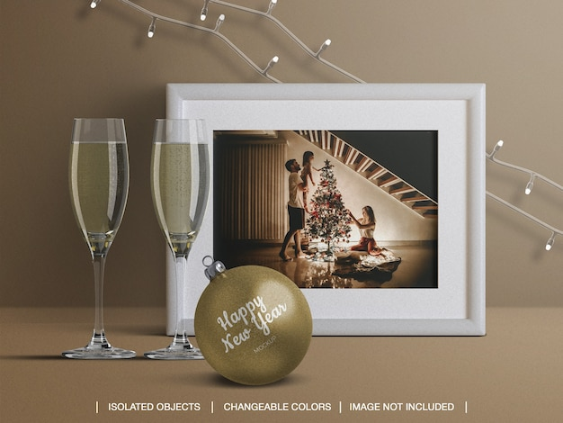 Mockup of holiday card frame and christmas ball with champagne glasses decoration Premium Psd