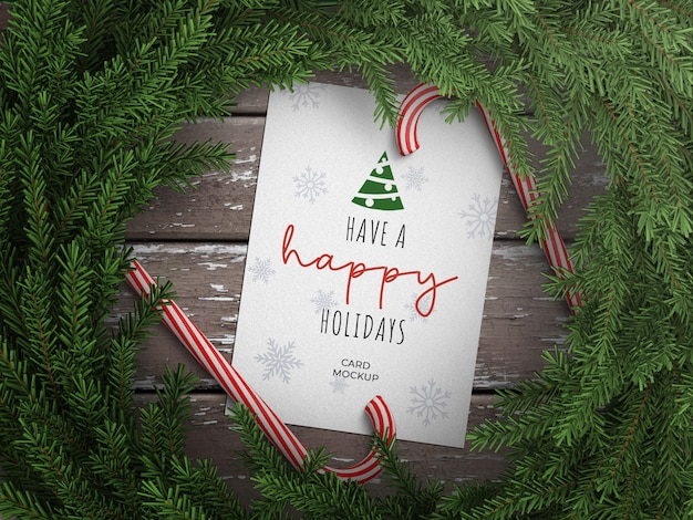 Mockup of holiday greeting card with lollipop cane and christmas wreath decoration on wooden table Premium Psd