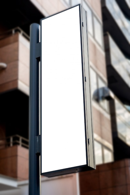 Mockup image of blank billboard white screen posters and led in front of hotel for advertising Premium Psd