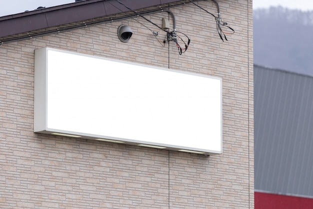 Mockup image of blank billboard white screen posters and led outside storefront for advertising Premium Psd