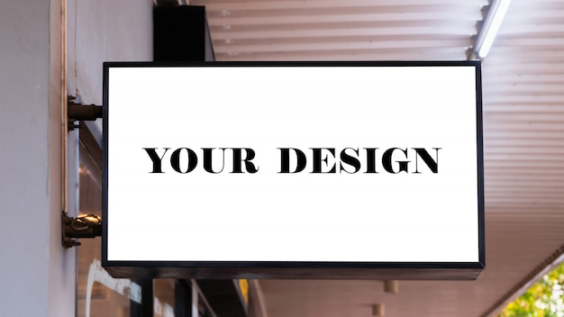 Mockup image of blank billboard white screen posters and led outside storefront Premium Psd