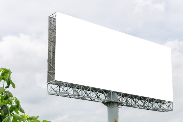 Mockup image of blank billboard white screen posters with white clouds sky for advertising Premium Psd