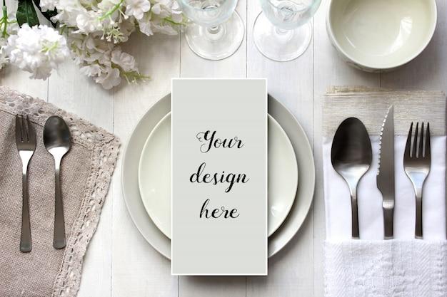 Mockup of menu card on arranged table Premium Psd
