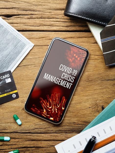 Covid19ビジネス危機管理概念のモックアップ携帯電話 Premium Psd