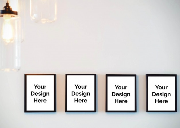 Mockup of four frames on wall PSD file | Premium Download