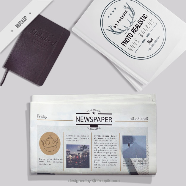 Mockup of newspaper with notebook and photo book Free Psd
