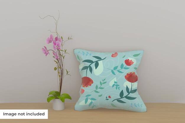 Макет подушки на полке с цветком Premium Psd
