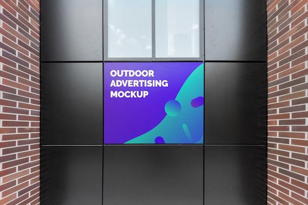 Mockup of outdoor advertising on black facade Premium Psd