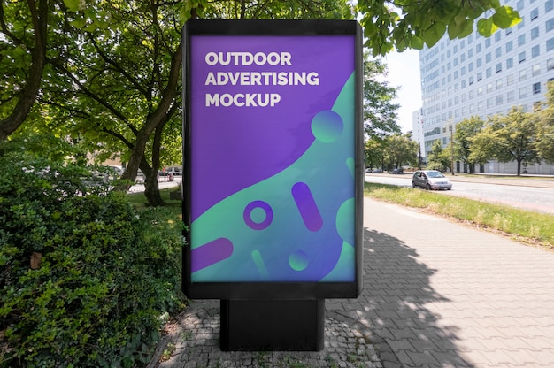 Mockup of outdoor black vertical advertising stand on city street pavement Premium Psd