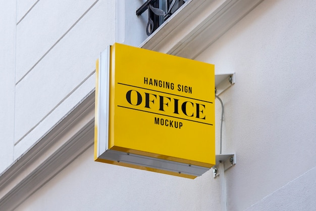Mockup of outdoor street urban colored square 3d logo sign hanging on the wall Premium Psd
