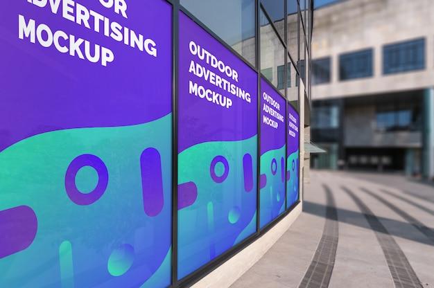 Mockup of outdoor vertical advertisings in window frames on modern building wall Premium Psd