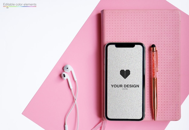 Mockup for phone with bullet journal pen and earphones Premium Psd