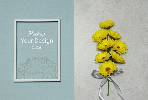 Mockup photo frame with yellow flowers on grey blue background Premium Psd