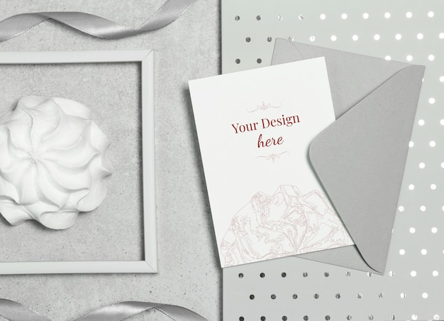 Mockup postcard on grey background with envelope, marshmallow and frame Premium Psd