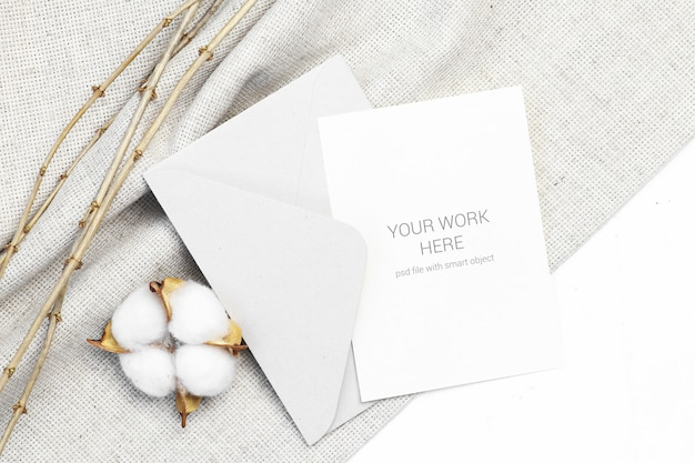 Mockup postcard with cotton and envelope Premium Psd