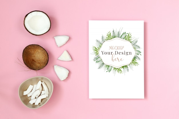 Mockup postcard with piece of coconut on pink background Premium Psd