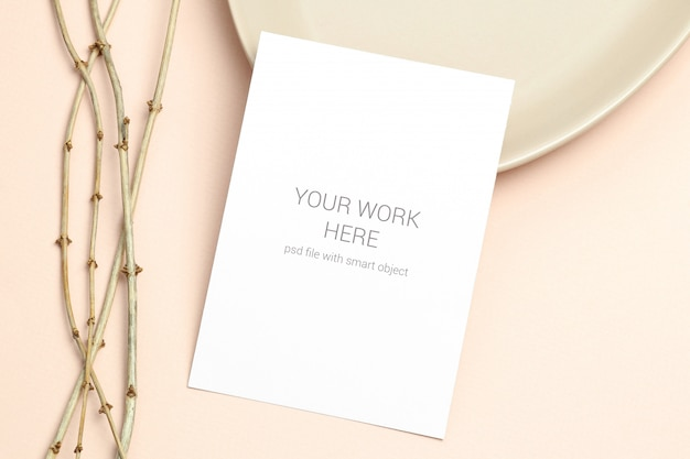 Mockup postcard with wooden branch on beige Premium Psd