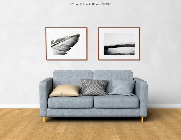 거실 현대적인 인테리어에 서있는 빈 나무 프레임에 모형 포스터 프레임. 무료 PSD 파일