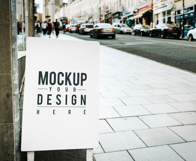 Mockup poster on the outside of a shop Free Psd