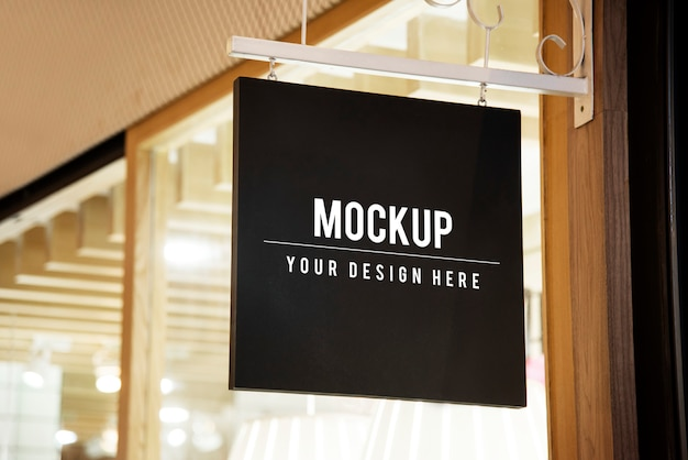 Mockup sign outside of a shop Free Psd