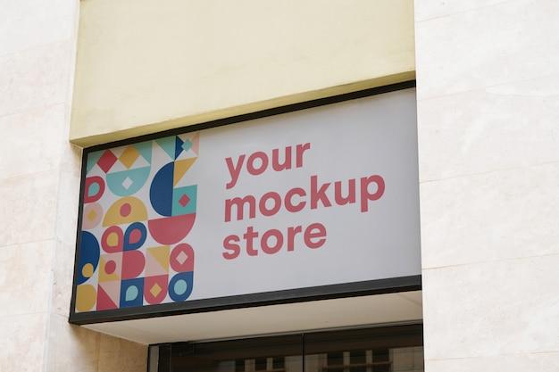 Mockup sign store city Free Psd
