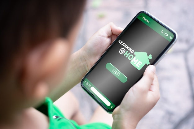 Mockup smartphone boy holding smartphone for learning at home concept