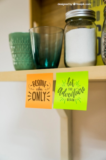 Mockup of sticky notes on kitchen cupboard Free Psd