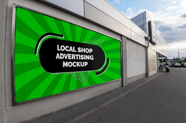 Mockup of the street city outdoor advertising horizontal billboard banner in silver frame at the local shop wall Premium Psd