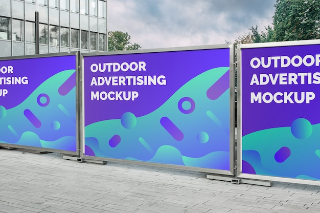 Mockup of the street city outdoor multiple horizontal billboards banners advertising on the silver metal fence Premium Psd