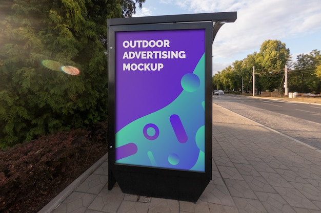Mockup of the street city outdoor poster banner advertising in the black vertical stand at the bus stop Premium Psd
