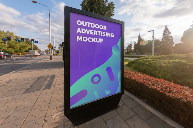 Mockup of the street city outdoor poster banner advertising in the black vertical stand Premium Psd