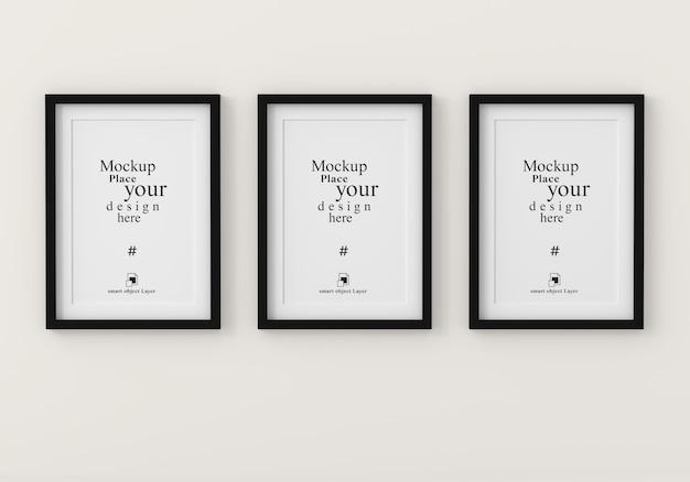Mockup three empty photo frame for mockup in empty white room Premium Psd