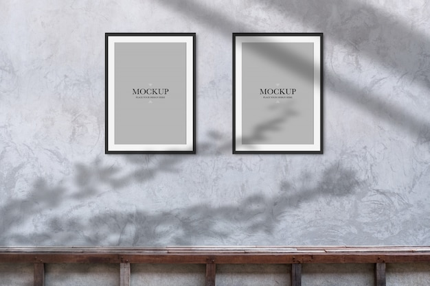 Mockup two blank photos frame on cement wall Premium Psd