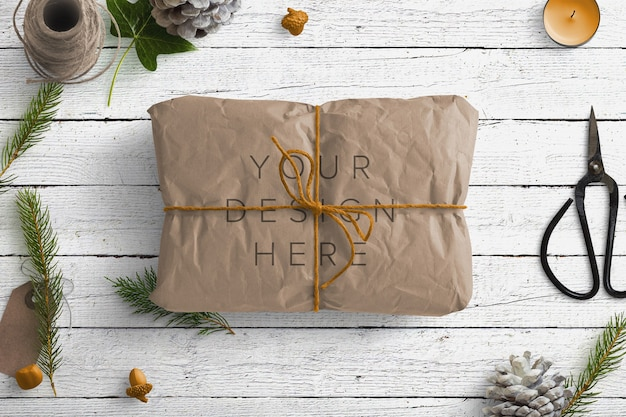 Mockup winter nature scene with brown parcel and gift items Premium Psd
