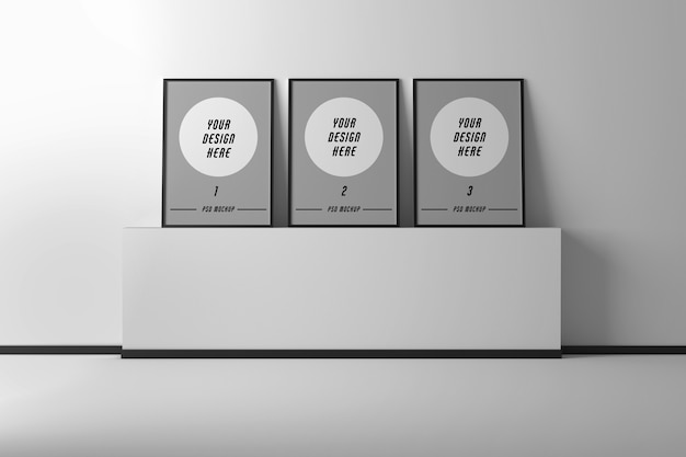 Mockup with three a4 picture frames on wall pedestal Premium Psd
