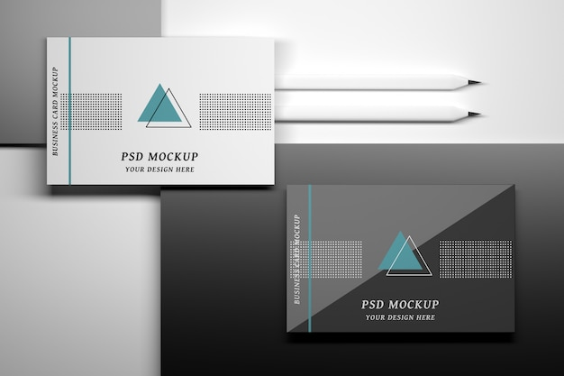 Mockup with top view of business cards and pencils Premium Psd