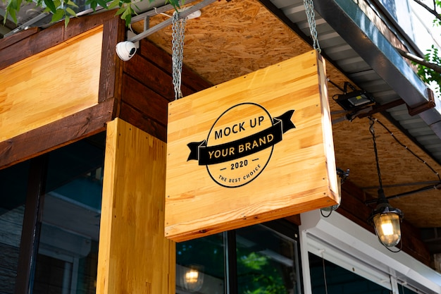 Mockup wooden signboard coffee shop Premium Psd