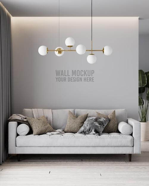 灰色のソファと枕とモダンなリビングルームの壁のモックアップ Premium Psd