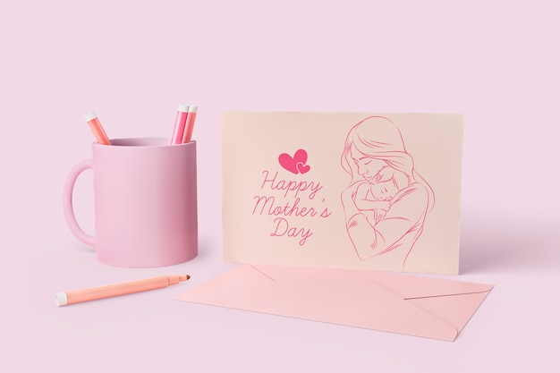 Mother's day celebration card and mug with mock-up Free Psd