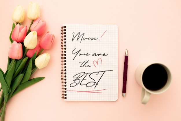Mother's day mockup notebook with tulips Free Psd