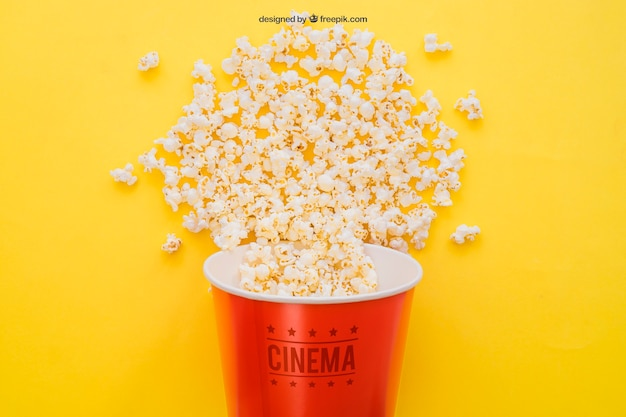 Movie mockup with popcorn bucket Free Psd