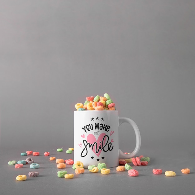 Mug mockup with colorful cereals Free Psd
