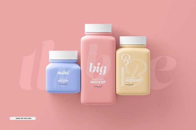 Мокап бутылки для пищевых добавок с квадратными таблетками разного размера Бесплатные Psd