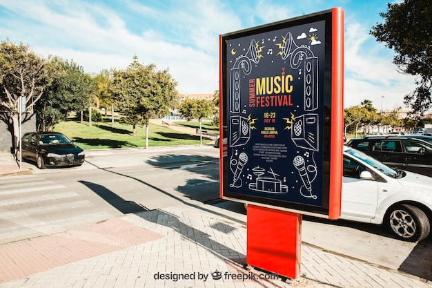 Mupi mockup in front of parked cars Free Psd