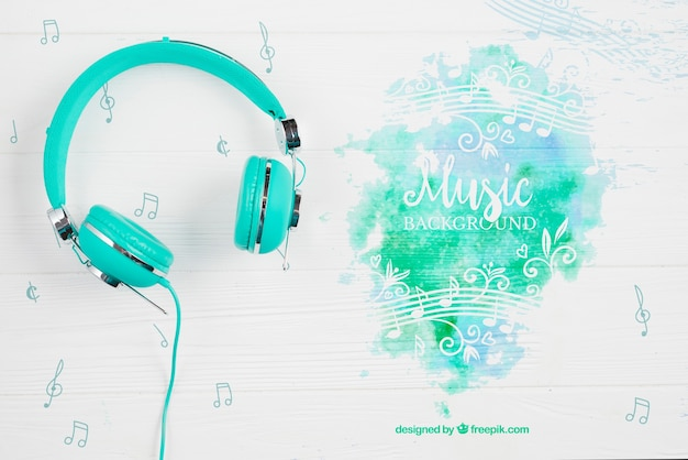 Music paint splash with headphones beside Premium Psd