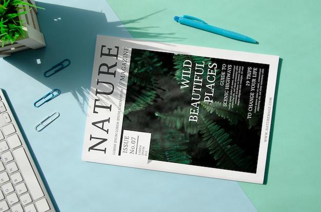 Nature magazine next to keyboard mock up Free Psd